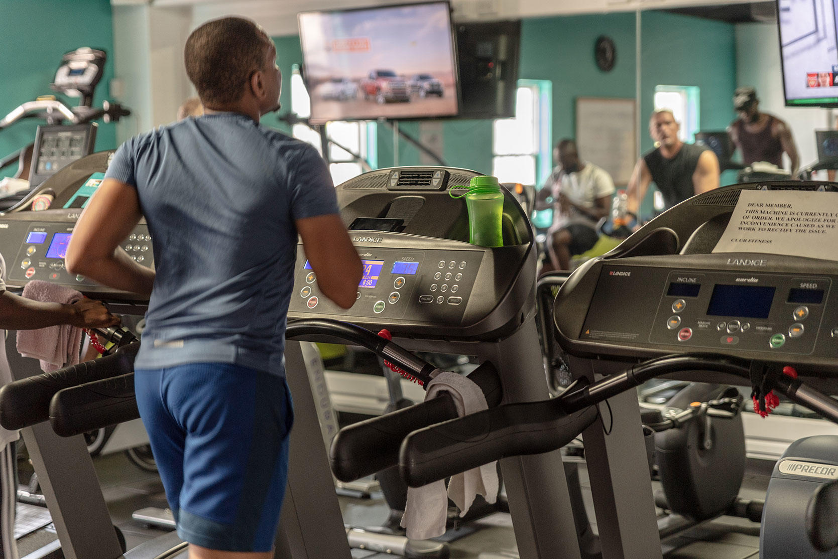Man running on treadmill in fitness center