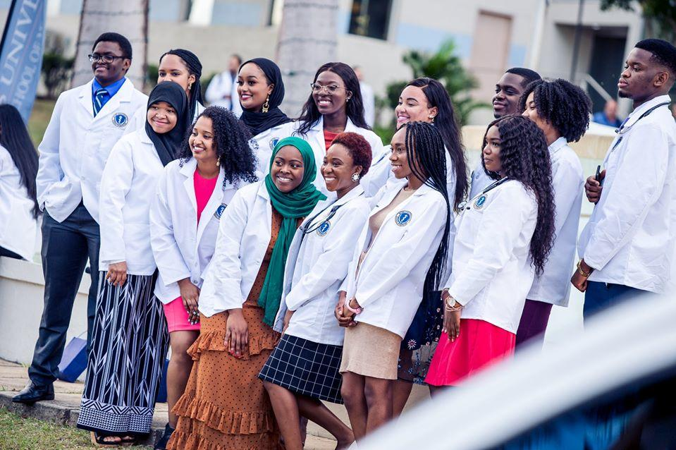 Medical students standing in a group posing for a picture