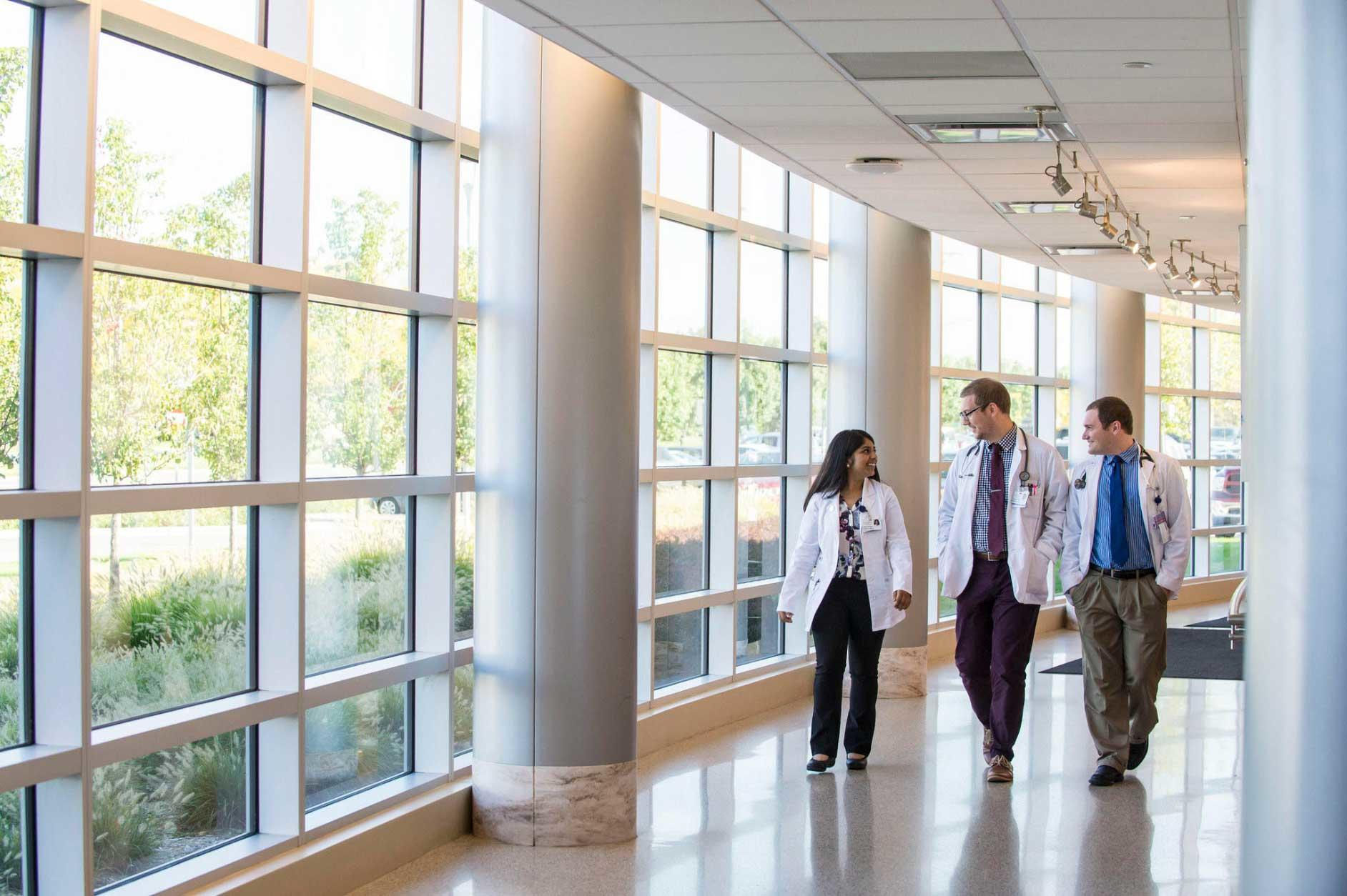 Doctors walking through hall