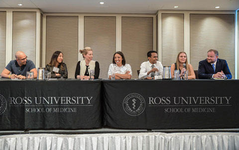 Group sitting on panel at Ross University